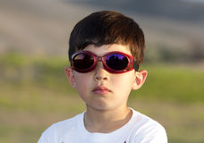 Boy wears colored goggles. Royalty Free Stock Image