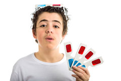 Boy wears 3D Cinema eyeglasses on his head and shows four ones i Stock Photo