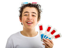 Boy wears 3D Cinema eyeglasses on his head and shows four ones i Royalty Free Stock Photography
