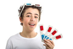 Boy wears 3D Cinema eyeglasses on his head and shows four ones i Royalty Free Stock Image