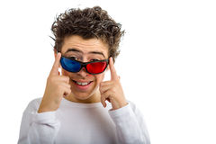 Boy wears 3D Cinema red and blue eyeglasses smiling. A cute Hispanic boy wears a pair of 3D Cinema eyeglasses with red and blue lenses and smiles royalty free stock photos