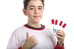 Boy wears 3D glasses and makes success sign showing four ones Royalty Free Stock Photos