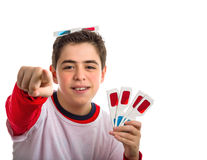 Boy wears 3D glasses showing other four ones and points index fi Stock Images