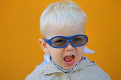 Boy wears glasses and he shouts royalty free stock images