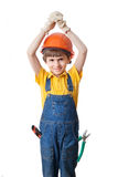 The boy wears hardhat and holds hands above head Royalty Free Stock Photo