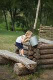 Boy at well of water in the village Stock Images