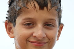 Boy with wet face and hair Stock Images