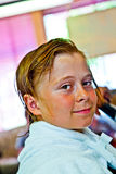 Boy with wet hair at the hairdresser Royalty Free Stock Image