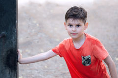 Boy with wet T-shirt. Playing with water. Royalty Free Stock Photography