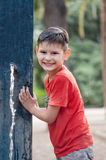 Boy with wet T-shirt. Playing with water. Water tap in the park. Stock Images