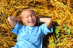 Boy in the wheat field Stock Image