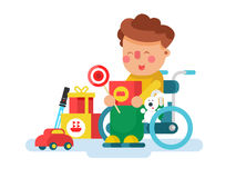 Boy in a wheel chair with toys Royalty Free Stock Photography