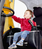 Boy at the wheel of excavator Stock Photo