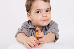 Boy which drawing of pencil. The little boy which drawing of pencil in notebook Stock Photo