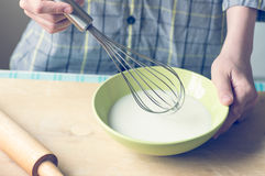 Boy with a whisk Stock Photo