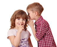 Boy whispering a secret Royalty Free Stock Images