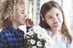 Boy whispering to girl`s ear Stock Photography