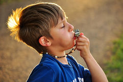 Boy with a whistle Royalty Free Stock Photography