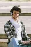 Boy whit headphones smiling Stock Photo