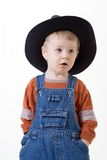 Boy on white background. Boy in hat has hidden hands in pockets Stock Photo