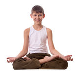 Boy on white background meditating Royalty Free Stock Photos