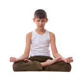 Boy on white background meditating Stock Image