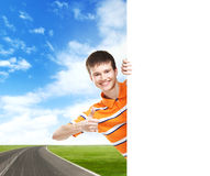 Boy with a white banner. Perfect space to put any text. Stock Photos