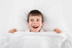 Boy in white bed Stock Photo