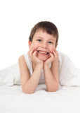 Boy in white bed Stock Image