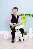 Boy on a white bicycle Royalty Free Stock Photo