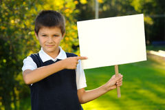 The boy with a white blank board. The boy is holding a white blank board Stock Images