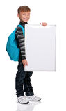Boy with white board. Happy boy with backpack and white board isolated on white background Royalty Free Stock Photos