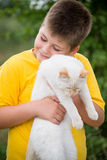 Boy with white cat Royalty Free Stock Photos