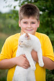 Boy with white cat Royalty Free Stock Images