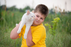 Boy with white cat Royalty Free Stock Photography