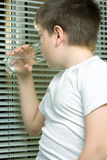 Boy in white drinking water Stock Photography