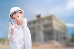Boy with white helmet in construction site. Royalty Free Stock Images