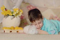 A boy and a white rabbit Stock Photos