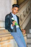 Boy with white rose Royalty Free Stock Photo