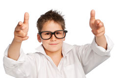 Boy in white shirt and big glasses. Cute boy wearing a white shirt and big glasses. Studio shot on white background Stock Photos