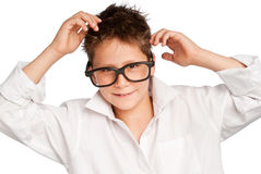Boy in white shirt and big glasses. Cute boy wearing a white shirt and big glasses. Studio shot on white background Royalty Free Stock Images
