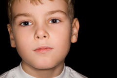 Boy in white T-shirt isolated on black background Royalty Free Stock Photos
