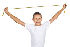 Boy in white T-shirt streching golden rope Royalty Free Stock Images