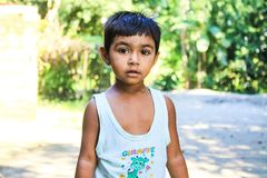Boy in White Tank Top Standing on Focus Photo royalty free stock image