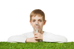 Boy in white using inhalator mask Royalty Free Stock Images