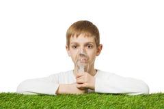 Boy in white using inhalator mask Royalty Free Stock Images