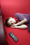 Boy who has fallen asleep in front of the TV Royalty Free Stock Photo