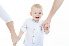 Boy who help walk with is parent on white Royalty Free Stock Images
