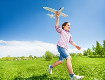 Boy who is holding airplane toy during running Royalty Free Stock Image