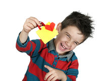 Boy who laughs and holds Shopping bag with heart. Stock Image